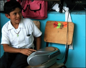 "A boy plays the music for the game called ""Lemon, Half-Lemon"""