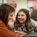 Mentors work with students at Garry Middle School. Bailley Wootton, mentoring programs manager for Gonzaga�s CCASL, and John Traynor, Jr., GU School of Education, will co-direct the project. (Gonzaga photo)