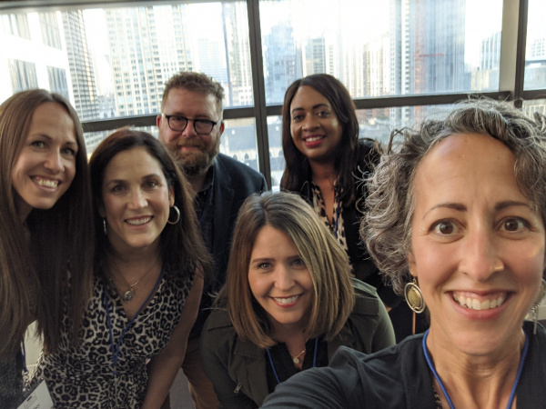 Group of six people posing for a selfie at the AJCU Leadership Institute conference in Chicago.