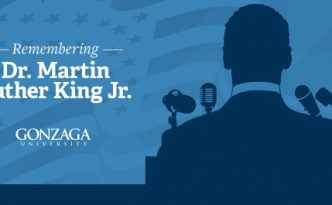 Remembering Dr. Martin Luther King Jr. with a silhouette of Marting Luther King Jr.
